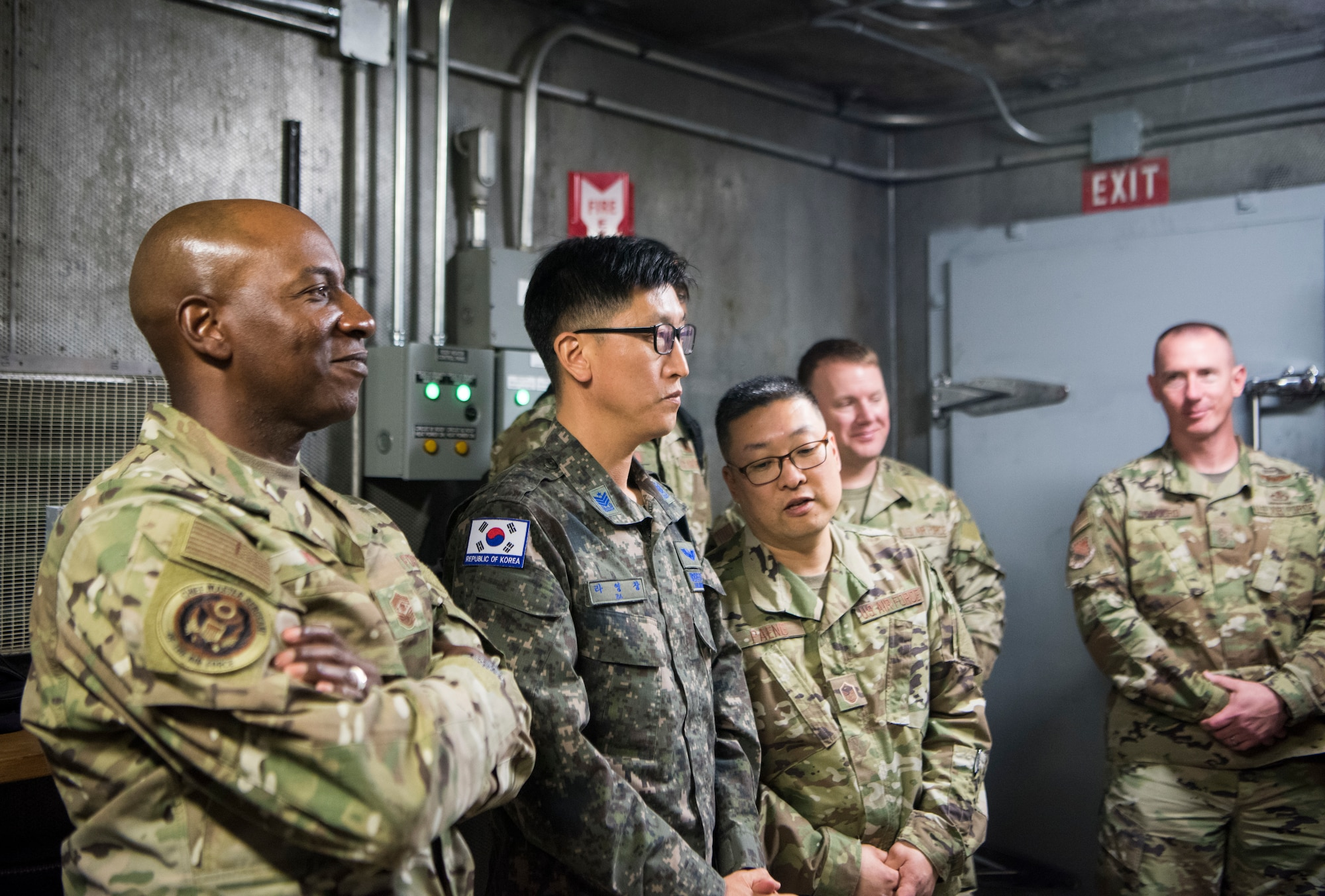 Chief Master Sergeant of the Air Force Kaleth O. Wright, chief master sergeant of the Republic of Korea, Ra Young-Chang and Joint Base Elmendorf-Richardson senior enlisted leaders are briefed before an F-22 jet engine test cell function check at JBER, Alaska, June 10, 2019. Chief Wright visited JBER during Red Flag-Alaska 19-2 to meet with his senior enlisted leader counterparts from throughout the Pacific. Red Flag-Alaska is a Pacific Air Forces-directed exercise that allows U.S. forces to train with coalition partners in a simulated combat environment.