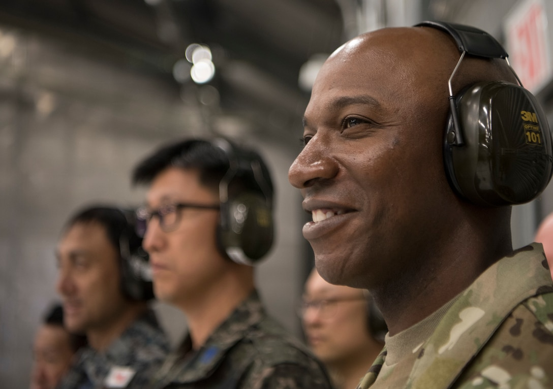 Chief Master Sergeant of the Air Force Kaleth O. Wright, chief master sergeant of the Republic of Korea, Ra Young-Chang and Joint Base Elmendorf-Richardson senior enlisted leaders watch during an F-22 jet engine test cell function check at JBER, Alaska, June 10, 2019. Chief Wright visited JBER during Red Flag-Alaska 19-2 to meet with his senior enlisted leader counterparts from throughout the Pacific. Red Flag-Alaska is a Pacific Air Forces-directed exercise that allows U.S. forces to train with coalition partners in a simulated combat environment.