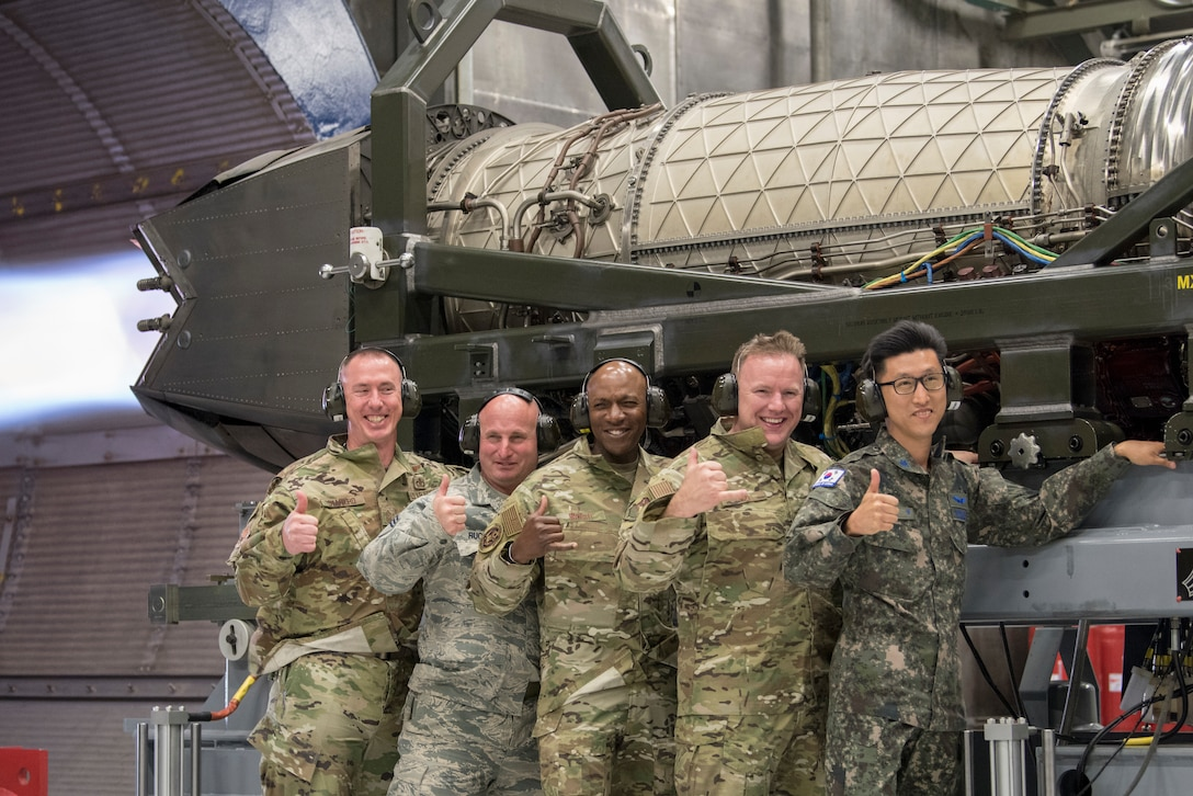Chief Master Sergeant of the Air Force Kaleth O. Wright, chief master sergeant of the Republic of Korea Young Chan Ra and Joint Base Elmendorf-Richardson senior enlisted leaders pose for a photo during an F-22 jet engine test cell function check at JBER, Alaska, June 10, 2019. Chief Wright visited JBER during Red Flag-Alaska 19-2 to meet with his senior enlisted leader counterparts from throughout the Pacific. Red Flag-Alaska is a Pacific Air Forces-directed exercise that allows U.S. forces to train with coalition partners in a simulated combat environment.
