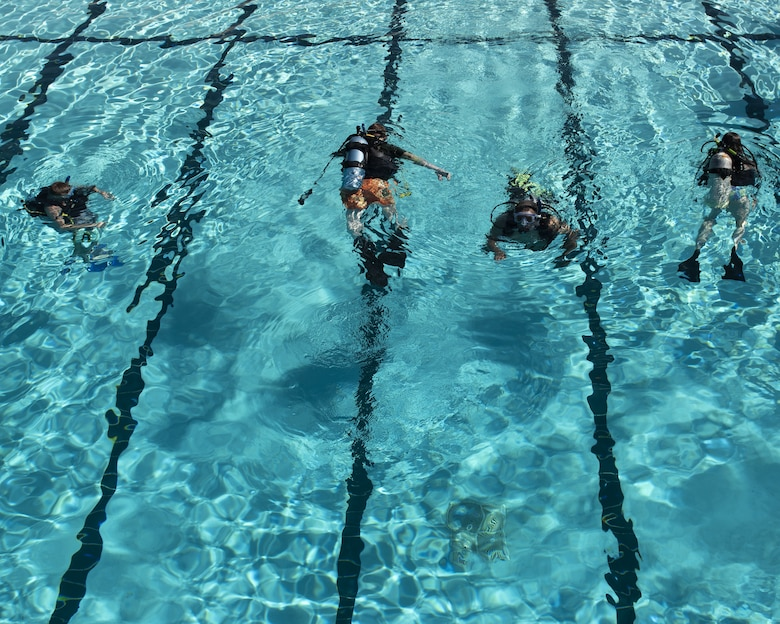 Scuba students dive to retrieve golf balls as part of the scuba diving class June 8, 2019, at Luke Air Force Base, Ariz.