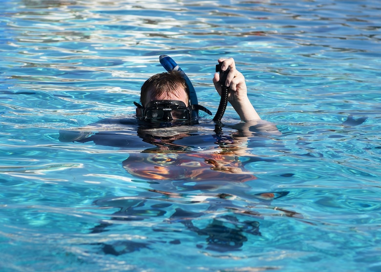 A scuba student empties the air out of his buoyancy compensator during a scuba diving class June 8, 2019, at Luke Air Force Base, Ariz.