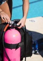 A scuba student prepares a scuba tank before diving June 8, 2019, at Luke Air Force Base, Ariz.