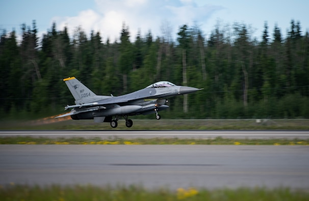 "An F-16 Fighting Falcon from the 80th Fighter Squadron ""Juvats"", Kunsan Air Base, Republic of Korea, takes off at Eielson Air Force Base, Alaska, June 10, 2019. Red Flag Alaska gives Kunsan pilots the unique opportunity to train in U.S. airspace and improve interoperability with a number of allies while using live munitions at the Joint Pacific Alaska Range Complex. (U.S. Air Force photo by Senior Airman Stefan Alvarez)"