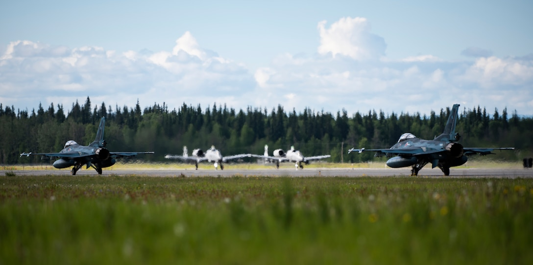 Japan Air Self-Defense Force F-2s from the 3rd Air Wing, Misawa Air Base, Japan, taxi down the runway at Eielson Air Force Base, Alaska, June 10, 2019. The 3rd Wing is participating in Red Flag-Alaska, a large-scale training exercise, with units and allied nations' air forces from around the Pacific. (U.S. Air Force photo by Senior Airman Stefan Alvarez