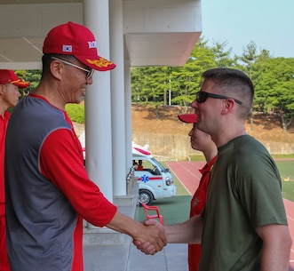 BARAN, Republic of Korea – U.S. and Republic of Korea Marines gather to partake in a field meet involving multiple games and competitions and ending with an awards and recognition ceremony here, June 12. The Marines competed in soccer, foot volleyball, a three legged race, and a 1200 meter relay race as part of an event to enhance the ROK-U.S. Alliance and strengthen the relationship between the two countries' Marine Forces. (Official U.S. Marine Corps photos by Sgt. Nathaniel Hanscom/Released)