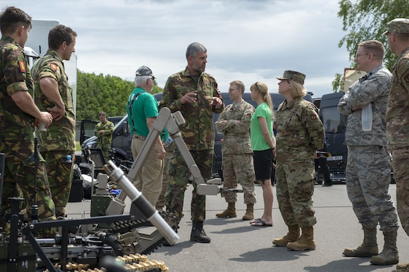 U.S. Air Force Col. Marlyce Roth, 52nd Mission Support Group commander and 52nd Civil Engineer Squadron Explosive Ordnance Disposal leadership gets briefed from The Netherlands' EOD team during exercise Eifel Krabben at Spangdahlem Air Base, Germany, June 3, 2019. This multilateral exercise focused on locating and disarming improvised explosive devices with EOD members from NATO partners to include Belgium, Estonia, Germany, Netherland, Poland and Sweden. (U.S. Air Force photo by Airman 1st Class Branden Rae)