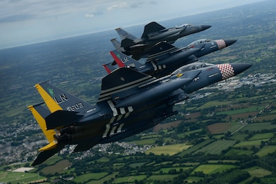 An F-15C Eagle and a pair of heritage painted F-15E Strike Eagles assigned to the 48th Fighter Wing conduct a flypast over Normandy, France in support of the 75th anniversary of D-Day June 9, 2019. An epic multinational operation, D-Day forged partnerships and reinforces trans-Atlantic bonds that remain to this day. (U.S. Air Force photo/ Tech. Sgt. Matthew Plew)