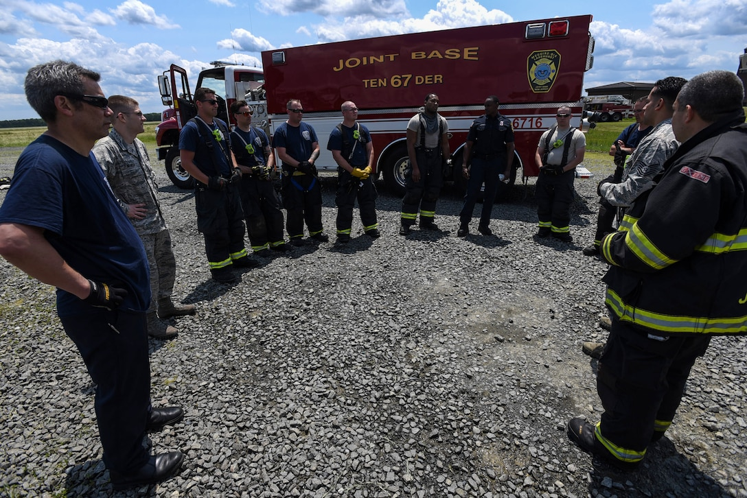 An 87th Civil Engineer Squadron fire department team review the fire training conducted on Joint Base McGuire-Dix-Lakehurst, New Jersey, June 3, 2019. The training is reviewed to recognize what was executed properly, what might have been done wrong and what can be improved. (U.S. Air Force photo by Airman 1st Class Ariel Owings)
