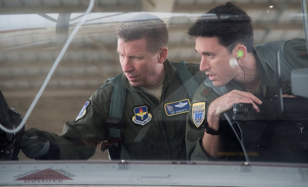 Maj. Gen. Patrick Doherty (left), 19th Air Force commander, and Maj. Lincoln Olsen, T-6 Texan II instructor pilot, conduct a T-6 Texan II safety check before conducting an operational demonstration at Joint Base San Antonio-Randolph Feb. 21, 2018. Doherty was on the flightline getting test data first-hand during the command-wide T-6 operational pause.