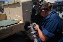 U.S. Marine Corps Lance Cpl. Leyah Schlaugh, a motor transportation operator with 2nd Transportation Support Battalion, Combat Logistics Regiment 2, 2nd Marine Logistics Group, refuels a Humvee during exercise Resolute Sun in N.C., June 11, 2019. Marines participated in the exercise to increase major combat operational readiness in amphibious and prepositioning operations while conducting joint training with the U.S. Army during a joint logistics over the shore scenario. (U.S. Marine Corps photo by Lance Cpl. Scott Jenkins)