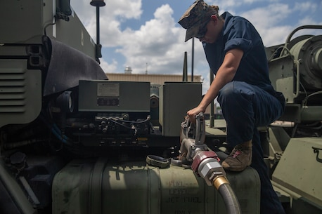 U.S. Marine Corps Lance Cpl. Leyah Schlaugh, a motor transportation operator with 2nd Transportation Support Battalion, Combat Logistics Regiment 2, 2nd Marine Logistics Group, refuels a logistics vehicle system replacement during exercise Resolute Sun in N.C., June 11, 2019. Marines participated in the exercise to increase major combat operational readiness in amphibious and prepositioning operations while conducting joint training with the U.S. Army during a joint logistics over the shore scenario. (U.S. Marine Corps photo by Lance Cpl. Scott Jenkins)