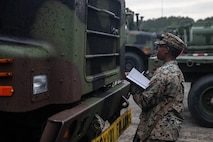 U.S. Marine Corps Lance Cpl. Tiana Stevens, an embarkation specialist with 2nd Transportation Support Battalion, Combat Logistics Regiment 2, 2nd Marine Logistics Group, confirms serial numbers of vehicles during exercise Resolute Sun at Joint Base Charleston, S.C., June 11, 2019. Marines participated in the exercise to increase major combat operational readiness in amphibious and prepositioning operations while conducting joint training with the U.S. Army during a joint logistics over the shore scenario. (U.S. Marine Corps photo by Lance Cpl. Scott Jenkins)