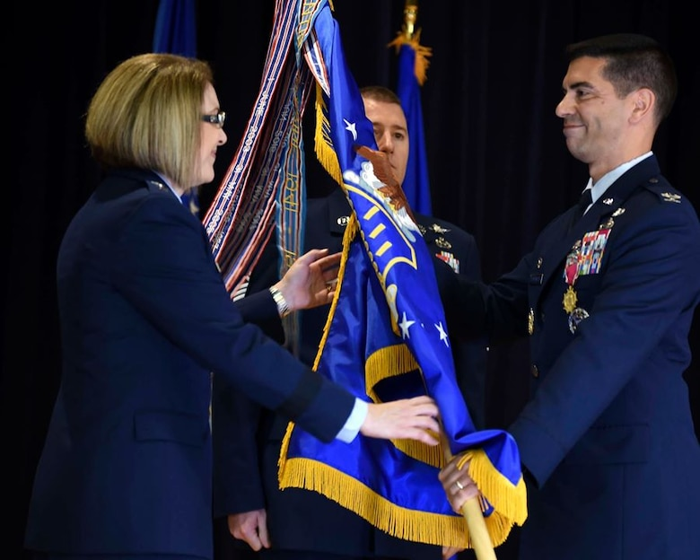 """U.S. Air Force Maj. Gen. Mary F. O'Brien, Twenty-Fifth Air Force commander, takes the guidon from Col. Matteo """"Mooch"""" Martemucci, 70th Intelligence, Surveillance and Reconnaissance Wing outgoing commander, during a change of command at Fort George G. Meade, Maryland, June 10, 2019. Martemucci assumed command of the 70th ISRW in June 2016, and has led the historic wing to new heights, earning the 2018 Air Force Meritorious Unit award; transforming the National to Tactical Intelligence flow, ensuring vital intelligence reached warfighters; and creating the Benjamin D. Foulois Center, leading the way in innovation. (U.S. Air Force photo by Senior Airman Gerald Willis)"""
