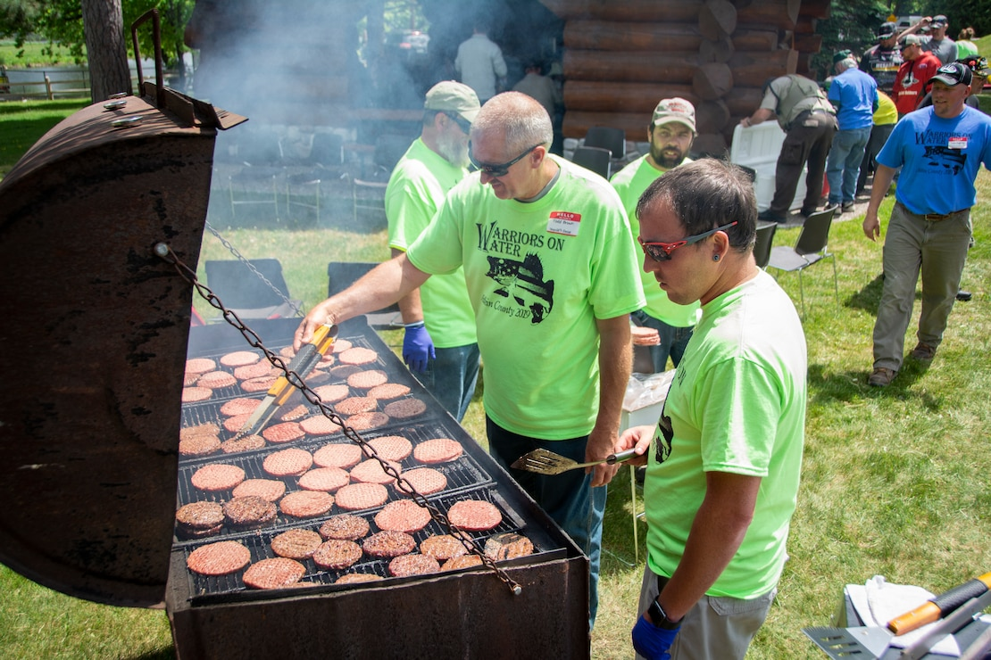 veterans enjoy a barbecue meal