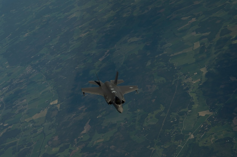 The F-35A flew alongside two Finnish F-18 Hornet aircraft as part of a Theater Security Package.