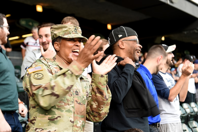 Master Sgt. Shandrel Daniels cheers during the Chicago White Sox vs Washington Nationals game at Guaranteed Rate Field, June 11, 2019.