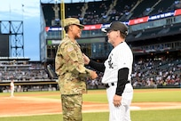 Master Sgt. Shandrel Daniels meets Chicago White Sox third base coach, Nick Capra, during the White Sox vs Washington Nationals game at Guaranteed Rate Field, June 11, 2019.