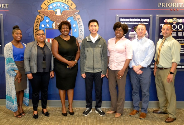 Ning Cao, a former DLA Troop Support intern, center, poses with members of the DLA Troop Support Corporate Communications office and the Philadelphia School District at DLA Troop Support June 5, 2019 in Philadelphia.