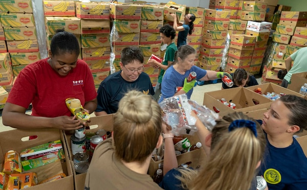 Navy Medicine Education, Training and Logistics Command Sailors sort food during a volunteer community outreach event at the San Antonio Food Bank June 11. The outreach event was part of the Navy's Sailor 360, a command-level program for junior enlisted, senior enlisted and junior officers, designed to strengthen and develop leadership through outreach events, classroom discussions and physical training.