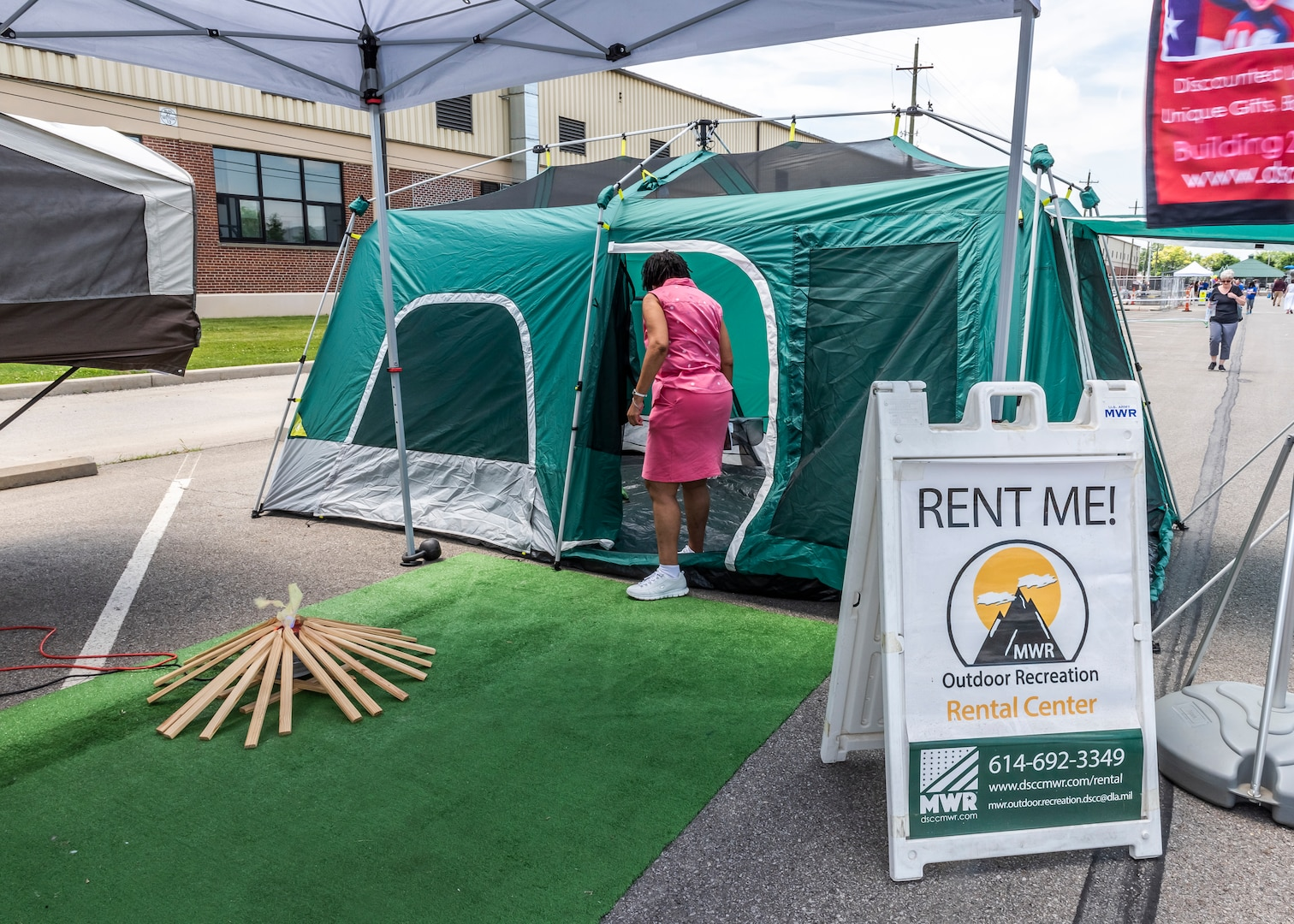 Associate looks at rental tent