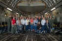 Local Educators pose for a photo in the back of a C-17 Globemaster III. Educators were invited onto Joint Base McGuire-Dix-Lakehurst to learn about the daily operations of the 514th Air Mobility Wing and the Air Force Reserve during Operation Bright Future June 8 2019.