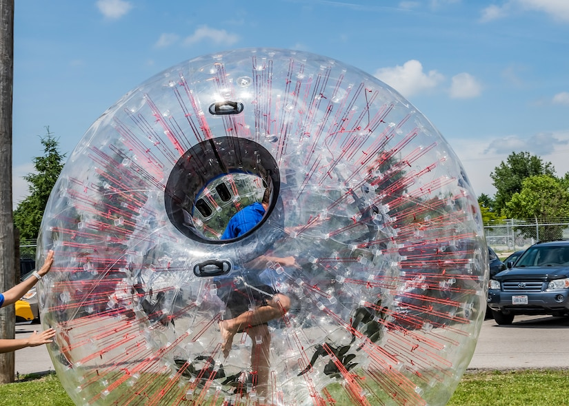 Person in a clear plastic ball