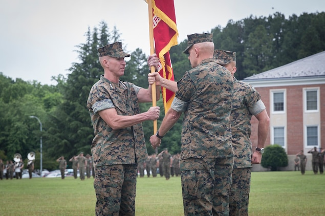 U.S. Marine Corps Lt. Gen. David H. Berger, right, out going commanding general, Marine Corps Combat Development Command (MCCDC), and out going deputy commandant, Combat Development and Integration (CD&I), transfers command to Lt. Gen. Eric M. Smith, oncoming commanding general, MCCDC, and oncoming deputy commandant, CD&I, at Lejeune Field, Quantico, Va., June 13, 2019. Berger joined MCCDC August 2018. (U.S. Marine Corps photo by Cpl. Cristian L. Ricardo)