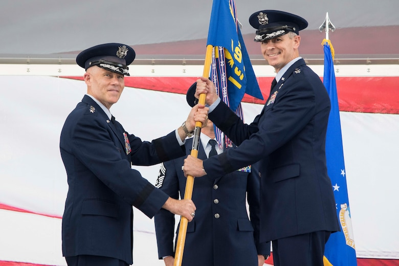 Lt. Gen. Steve Kwast, commander of Air Education and Training Command, passes the 19th Air Force guidon to Maj. Gen. Craig Wills, during the 19th Air Force change of command ceremony June 13, 2019, at Joint Base San Antonio-Randolph, Texas.  The numbered Air Force oversees 19 training locations, with 17 Total Force wings, 11 active duty, one Air Force Reserve and five Air National Guard units.  More than 32,000 members of the 19th Air Force operate more than 1,600 aircraft from 29 different aircraft models. (U.S. Air Force photo by Sean M. Worrell)