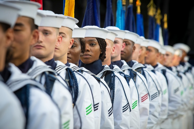 A group of sailors stand in a line.