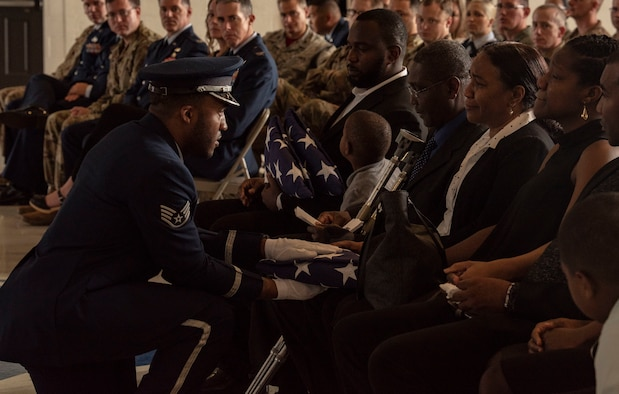 The American flag is presented to the son of Staff Sgt. Amalia Joseph, 20th Component Maintenance Squadron electronic warfare journeyman, during a memorial service at Shaw Air Force Base, South Carolina, June 7, 2019.