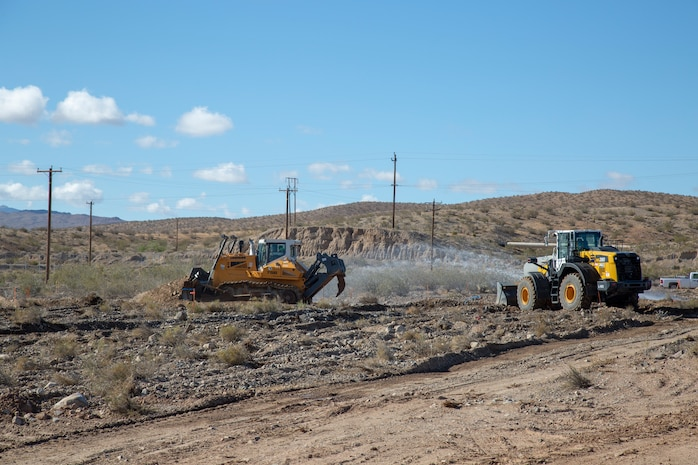 Contractors use water to control the dust created as they work to remove contaminated soil during an Installation Restoration project aboard Marine Corps Logistics Base Barstow, Calif., May 21.