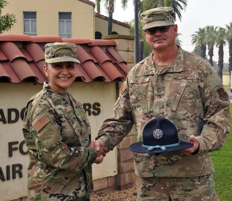 Chief Master Sgt. Cynthia Villa, 4th Air Force command chief,  shakes hands with her former basic military training instructor Chief Master Sgt. Steve Simpson, June 13, 2019 at March Air Reserve Base, California. (U.S. Air Force photo by Candy Knight)