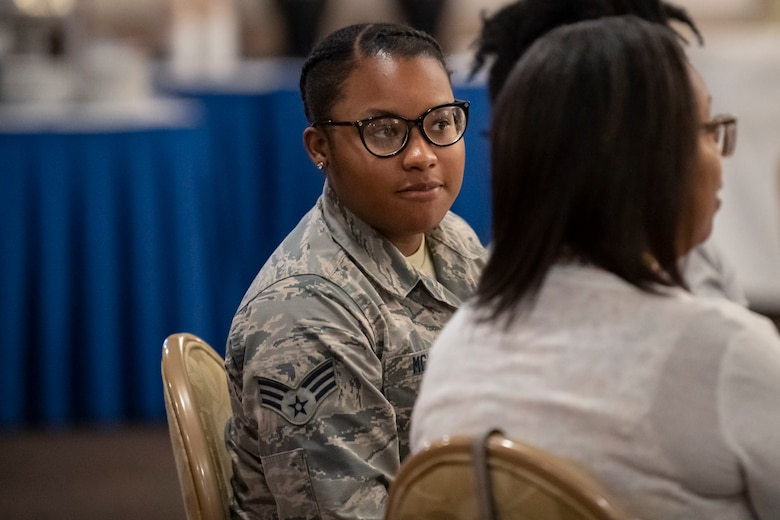 U.S. Air Force Senior Airman Diamond McNutt, a material management specialist assigned to the 307th Logistics and Readiness Squadron, listens to a speaker at the Shreveport Bossier Military Affairs Council quarterly update luncheon at Barksdale Air Force Base, Louisiana, June 12, 2019. McNutt earned a $1,000 scholarship from the MAC, which she will use to earn a bachelor's degree in biology. (U.S. Air Force photo by Senior Airman Maxwell Daigle)