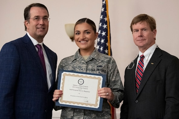 Representatives from the Shreveport-Bossier Military Affairs council present a $1,000 academic scholarship to U.S. Air Force Staff Sgt. Sara Hagmeier, 307th Maintenance Group aircraft scheduler, at Barksdale Air Force Base, Louisiana, June 12, 2019. Hagmeier will use her scholarship to earn an associate's degree in diagnostic medical sonography. (U.S. Air Force photo by Senior Airman Maxwell Daigle)