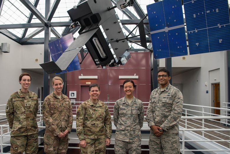 (From left to right) 1st Lt. Catherine Willis and 1st Lt. Robyn Hayes, incoming Space Intelligence Intern Program interns, Col. Suzy Streeter, Air Force Space Command/Intelligence, Surveillance and Reconnaissance director and 1st Lt. Rebecca Bosworth and Capt. Devin Hightower, current SIIP interns, stand in front of the Space-Based Infrared System model at HQ, AFSPC on Peterson Air Force Base, Colorado, June 11, 2019. The Airmen are involved in SIIP, a 24-month program designed to improve the space foundational intelligence base for participants to succeed in future space intelligence leadership roles. (U.S. Air Force photo by 2nd Lt. Kristen Shimkus)