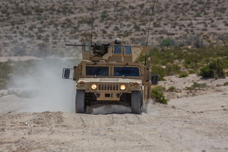 Marines ride in a vehicle during an exercise.