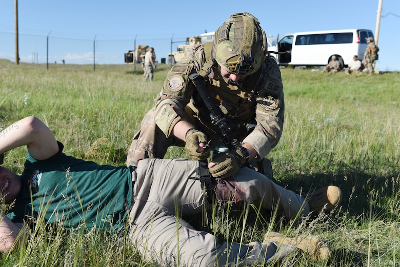 An Airman with the 341st Security Support Squadron tactical response force provides Tactical Combat Casualty Care during an integrated recapture and recovery exercise June 11, 2019, at an intercontinental ballistic missile launch facility near Simms, Mont.