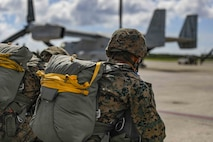 U.S. Marine Corps air delivery specialists prepare to board an MV-22 Osprey for an air delivery exercise June 6, 2019 on Marine Corps Air Station Futenma, Okinawa, Japan. Air delivery specialists with Air Delivery Platoon, Landing Support Company, 3rd Transportation Support Battalion, Combat Logistics Regiment 3, 3rd Marine Logistics Group, employed the Joint Precision Airdrop System to enhance mission readiness by providing hands-on rehearsals. The JPADS is an autonomous system designed to provide accurate delivery of cargo and supplies to ground component forces. (U.S. Marine Corps photo by Lance Cpl. Mark Fike)