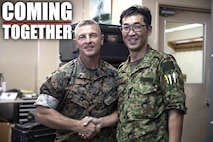 U.S. Marine Corps Chief Warrant Officer 4 Roderick Palmer shakes hands with Japanese Ground Self-Defense Force Capt. Yuki Sonoda during a community exchange program tour on Camp Kinser, Okinawa, Japan June 7, 2019. During the tour, hosted by Combat Logistics Regiment 35, service members visited the base dining facility, supply management unit, a maintenance shop and the Battle of Okinawa historical display, before taking part in a social at the USO. The purpose of the program is to create bonds and increase operational understanding between the JGSDF and the U.S. Marine Corps. Palmer, the company commander of Maintenance Company, CLR-35, 3rd Marine Logistics Group, is a native of Tallahassee, Florida. Sonoda is a native of Fukuoka, Japan.  (U.S. Marine Corps photo by Pfc. Courtney A. Robertson)