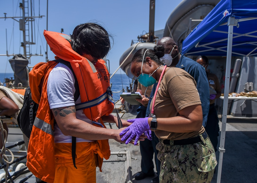 GULF OF OMAN (June 13, 2019) Sailors aboard the Arleigh Burke-class guided-missile destroyer USS Bainbridge (DDG 96) render aid to the crew of the M/V Kokuka Courageous. Bainbridge is deployed to the U.S. 5th Fleet areas of operations in support of naval operations to ensure maritime stability and security in the Central Region, connecting the Mediterranean and Pacific through the Western Indian Ocean and three strategic choke points. (U.S. Navy photo by Mass Communication Specialist 3rd Class Jason Waite/Released)