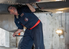 U.S. Air Force Staff Sgt. Brandon Deem, a dedicated crew chief assigned to the 67th Aircraft Maintenance Unit, inspects an F-15 Eagle at Kadena Air Base, Japan, June 11, 2019.