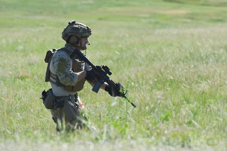 An Airman with the 341st Security Support Squadron tactical response force moves through a field during an integrated recapture and recovery exercise June 11, 2019, at an intercontinental ballistic missile launch facility near Simms, Mont.