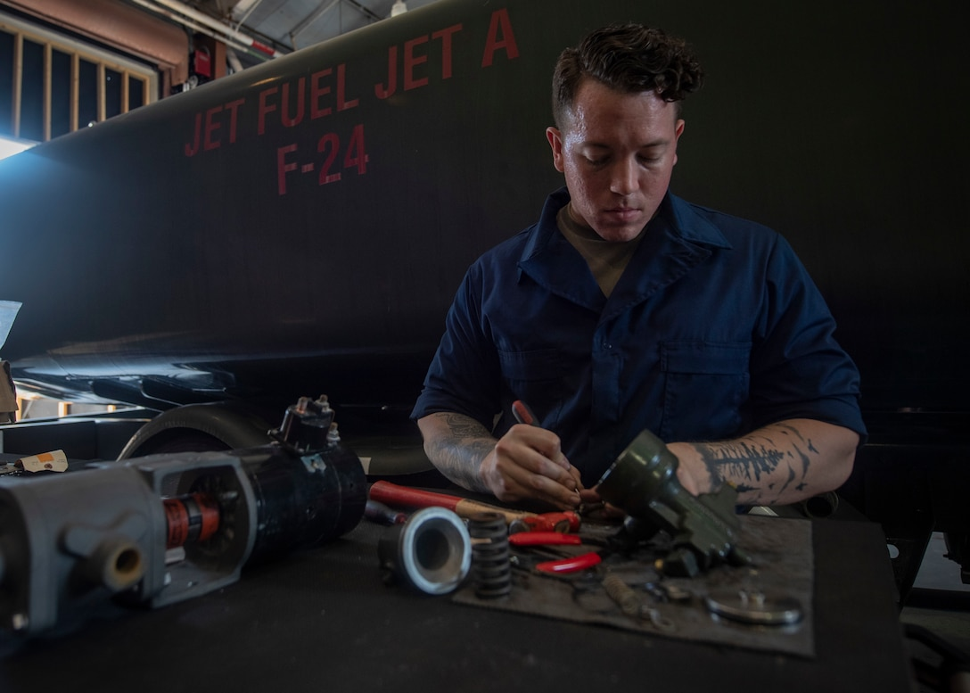 U.S. Air Force Staff Sgt. Jake Gonzalez, fire truck and refueling mechanic assigned temporarily assigned to the 325th Logistics Readiness Squadron, repairs a refueling truck component June 4, 2019, on Tyndall Air Force Base, Florida.