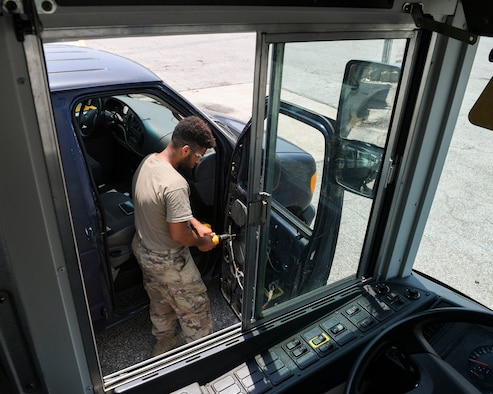U.S. Air Force Senior Airman Kayne Brown, vehicle mechanic temporarily assigned to the 325th Logistics Readiness Squadron, repairs a broken vehicle June 4, 2019, at Tyndall Air Force Base, Florida.