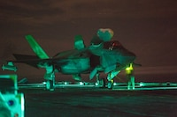 Marines with Marine Medium Tiltrotor Squadron 265 aboard the USS Wasp work on an F-35B Lightning II fighter aircraft during night time flight operations while underway in the Philippine Sea, June 9, 2019. The 31st Marine Expeditionary Unit, the Marine Corps` only continuously forward-deployed MEU, provides a flexible and lethal force ready to perform a wide range of military operations as the premier crisis response force in the Indo-Pacific region.