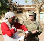 Dr. Theresa Aida B. Ndiaye, director of the Regional Center Hospital at Tambacounda, Senegal, and U.S. Army Maj. Christopher Gookin review the list of supplies that were brought to Senegal, on April 9, 2019. Vermont Guardsmen worked with their Senegalese  counterparts to share best practices while providing the Department of Defense with cost-effective ways to strengthen alliances and attract new partners in conjunction with the State Partnership Program.