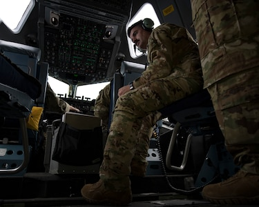 Maj. Jonathan Mahan, a C-17 Globemaster III pilot assigned to the 14th Airlift Squadron, listens to interaircraft communications May 14, 2019, during flight training operations over the Gulf of Mexico.