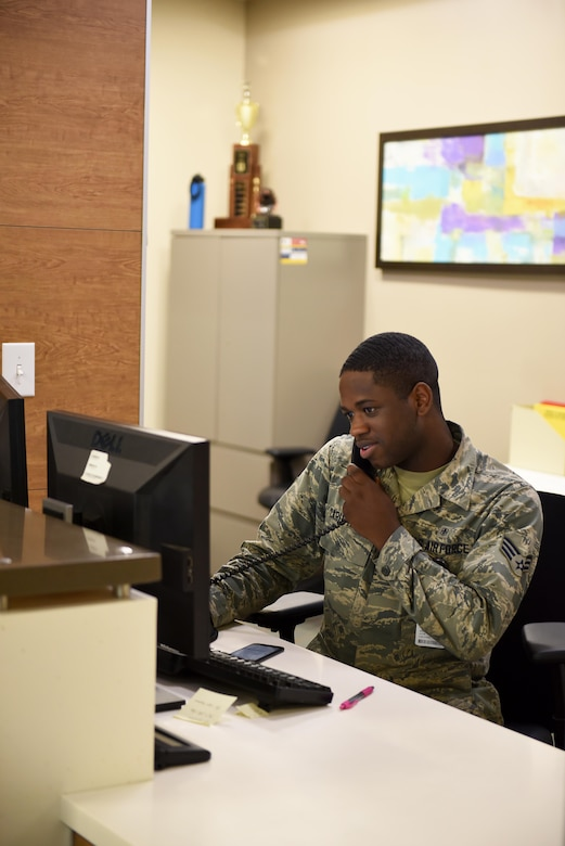 Senior Airman Jacob Caruthers, 14th Medical Operations Squadron family health office manager, speaks on the phone June 11, 2019, on Columbus Air Force Base, Mississippi. Caruthers and his co-workers work hard to help anyone with any medical group issue and will give directions on where to go or help schedule an appointment. (U.S. Air Force photo by Senior Airman Keith Holcomb)