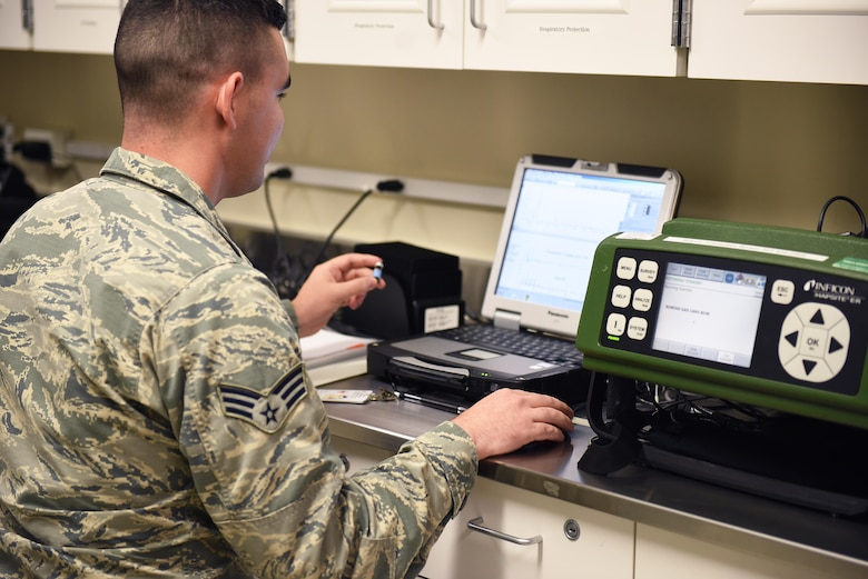 Senior Airman Michael Mannarino, 14th Medical Operations Squadron bioenvironmental technician, uses the field HAPSITE ER Chemical Identification System June 11, 2019, on Columbus Air Force Base, Mississippi. Bioenvironmental Airmen are responsible for testing the air supply in aircraft, water, and the air on base to ensure no dangerous chemicals can contaminate the base population or harm the pilot training mission. (U.S. Air Force photo by Senior Airman Keith Holcomb)
