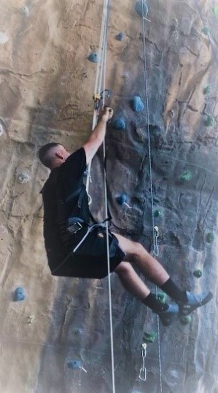 Sgt. 1st Class Nathan Simper on his way to the top of the rock with adaptive resources, March 2019 Fort Carson, Colorado. (Photo credit: Fort Carson WTU)